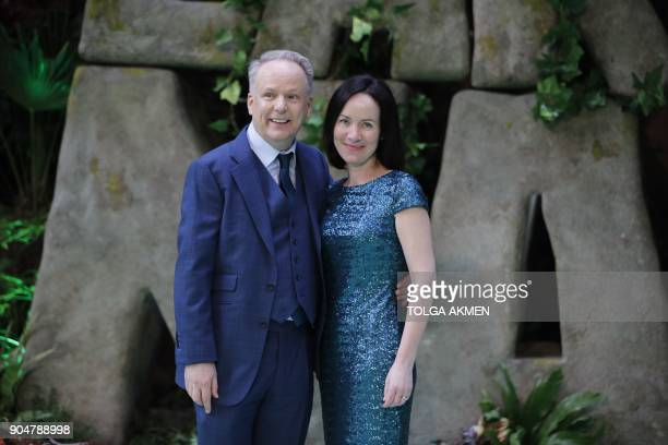 British director Nick Park and his wife Mags Connolly pose on the carpet arriving to attend the world premiere of the film Early Man in London on...