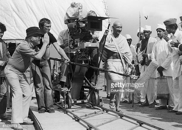 1982 British director Richard Attenborough left and his camera crew prepare to shoot a scene with actor Ben Kingsley as Mahatma Gandhi and group of...