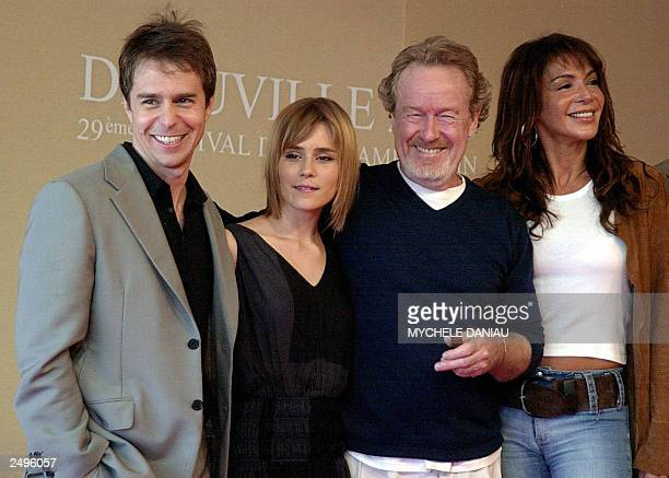 British director Sir Ridley Scott , accompanied by his wife Giannina Facio , co-producer of the movie, pose 13 September 2003, with the US actors...