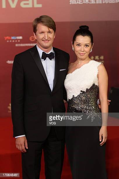 British director Tom Hooper and Chinese actress Yu Nan arrive at the opening ceremony of the 16th Shanghai International Film Festival at Shanghai...