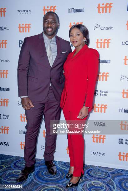 British director/actor Adewale AkinnuoyeAgbaje and Nigerian actress Genevieve Nnaji attend the Farming red carpet premiere during the Toronto...