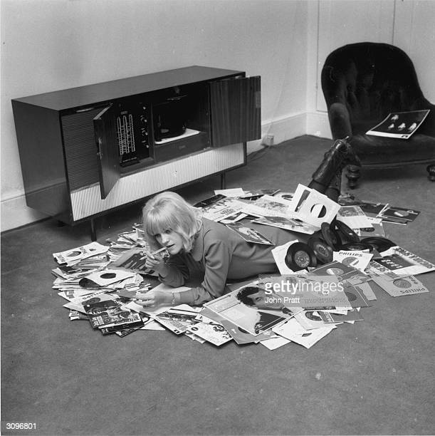 British disc jockey and television presenter Annie Nightingale relaxing at her home in Brighton with some of her records including albums by the...