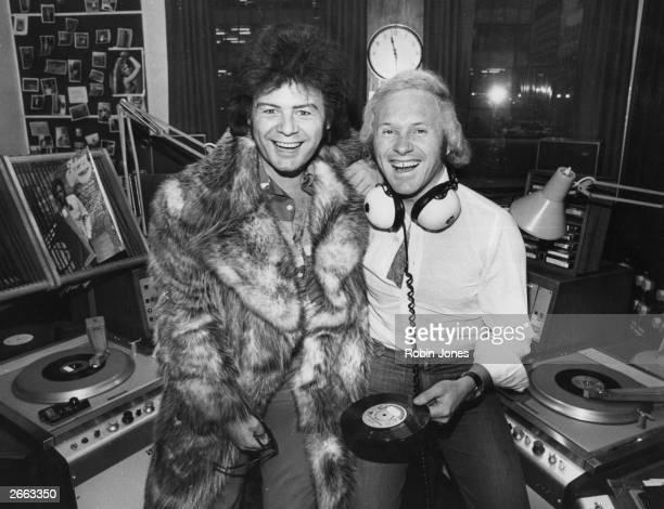 British disc jockey David Hamilton of BBC Radio One with pop star Gary Glitter and a copy of Glitter's new single 'Oh Yes You're Beautiful' Original...