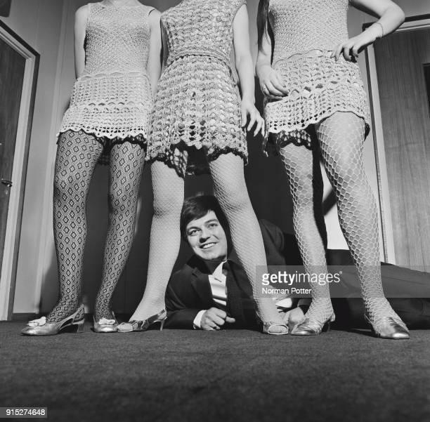 British disc jockey Tony Blackburn with Carol Ayres, Sue Collins and Sandra Tanner, UK, 13th February 1968.