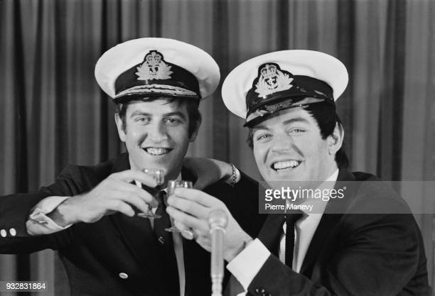 British disc jockeys Ed Stewart and Tony Blackburn at a Ministry of Defence office, celebrates after recording Christmas message to Royal Navy...