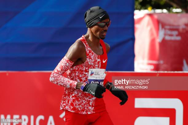 British distance runner Mo Farah crosses the finish line during the 2019 Bank of America Chicago Marathon on October 13, 2019 in Chicago, Illinois. -...