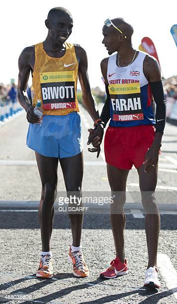 British distance runner Mo Farah is congratulated by second place finisher Kenyan Stanley Biwott after his victory in the Great North Run...