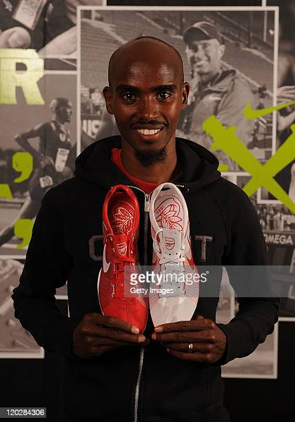 British distance runner Mo Farah poses with the Nike Zoom Victory Spikes given to him ahead of his race at Crystal Palace while appearing at a Nike...