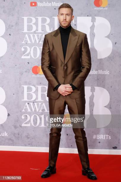 British DJ and musician Calvin Harris poses on the red carpet on arrival for the BRIT Awards 2019 in London on February 20 2019 / RESTRICTED TO...