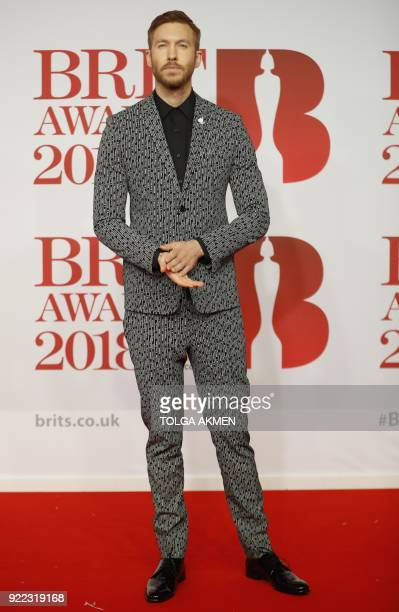 British DJ Calvin Harris poses on the red carpet on arrival for the BRIT Awards 2018 in London on February 21 2018 / AFP PHOTO / Tolga AKMEN /...