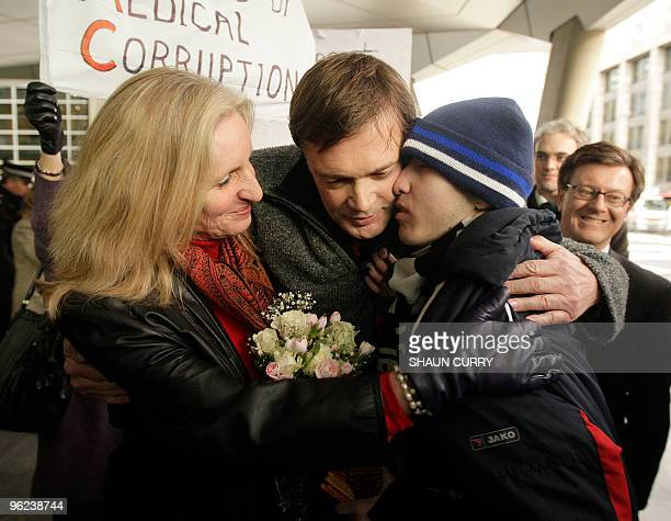 British Doctor Andrew Wakefield and his wife Carmel hug 17 year old autism sufferer Josh Edwards as the couple leave the grounds of the General...