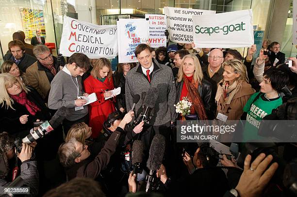 British Doctor Andrew Wakefield stands with his wife Carmel as he addresses the media in the grounds of the General Medical Council in central London...