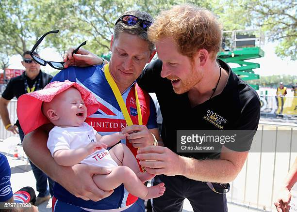 British double gold winner Rob CromeyHawke and his daughter Pippa meet Prince Harry at the road cycling event during the Invictus Games Orlando 2016...