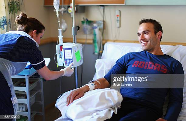 British doubles tennis specialist Ross Hutchins receives treatment for Hodgkin's lymphoma during his visit to the Royal Marsden Hospital on May 2,...