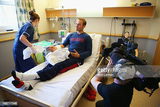 British doubles tennis specialist Ross Hutchins receives treatment for Hodgkin's lymphoma during his visit to the Royal Marsden Hospital on May 2...