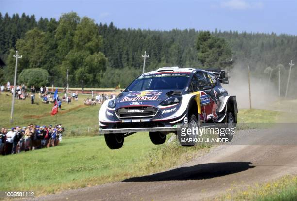 British driver Elfyn Evans and codriver Daniel Barritt get airborne with their MSport Ford Fiesta WRC car during the Kakaristo Special Stage of the...