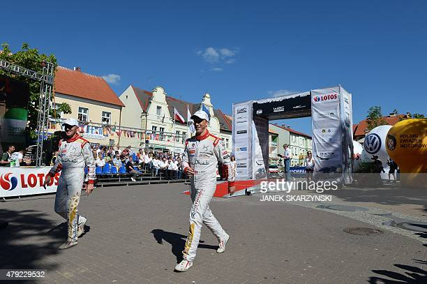 British driver Kris Meeke and his Irish codriver Paul Nagle attend the official start of Lotos Rally Poland on July 2 2015 at the main square in...