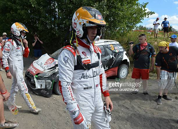 British driver Kris Meeke and his Irish codriver Paul Nagle react next to their destroyed Citroen DS3 WRC during the Lotos Rally Poland in Mikolajki...