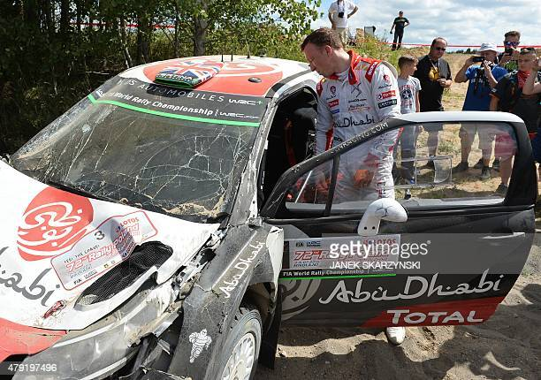 British driver Kris Meeke reacts next to his destroyed Citroen DS3 WRC during the Lotos Rally Poland in Mikolajki north Poland on July 2 2015 AFP...