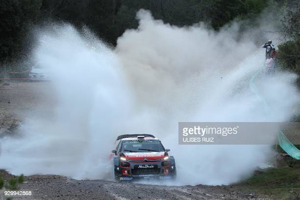 TOPSHOT British driver Kris Meeke steers his Citroen C3 with Irish codriver Paul Nagle during the first day of the 2018 FIA World Rally Championship...
