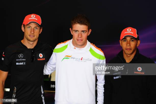 British drivers Jenson Button of McLaren, Paul di Resta of Force India and Lewis Hamilton of McLaren pose for a photograph before the drivers press...