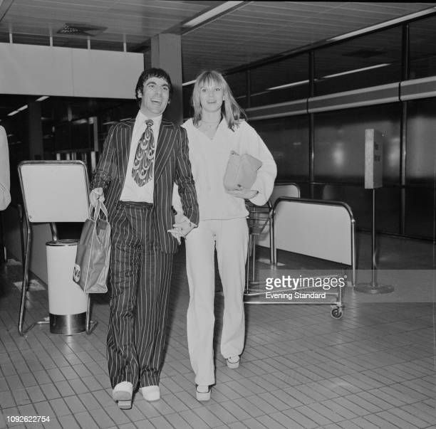 British drummer Keith Moon with his partner Swedish fashion model Annette WalterLax at the airport UK 1st May 1975