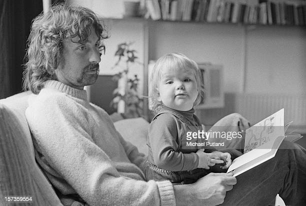 British drummer Nick Mason of rock group Pink Floyd with one of his daughters 12th October 1972