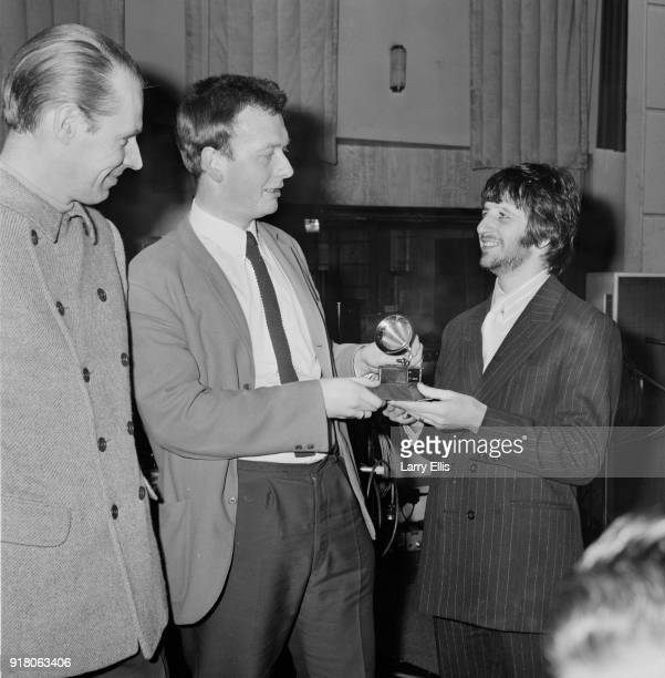British drummer Ringo Starr of The Beatles with studio audio engineer Geoff Emerick who won Grammy Award for the engineering of 'Sgt Pepper's Lonely...