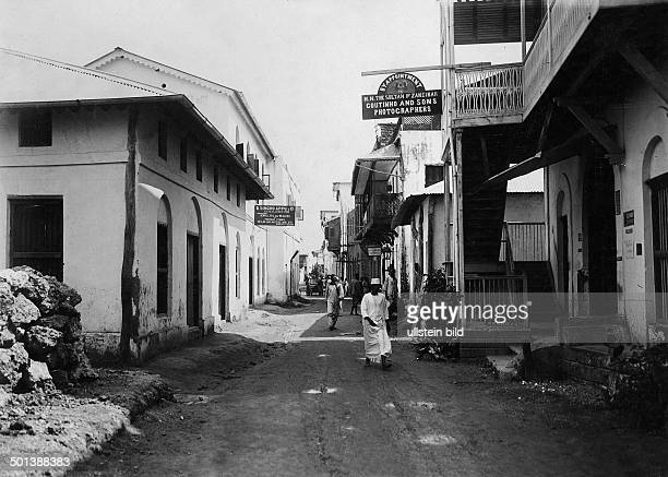 British East Africa Kenya Mombasa Island shopping street in Mombasa on the right a photographer's studio probably in the 1910s