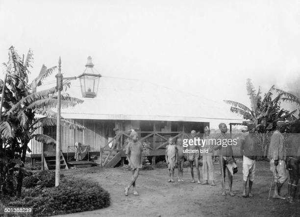 Natives in front of a station building of the Uganda Railway probably in the 1910s