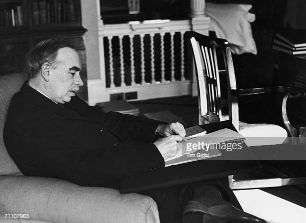 British economist John Maynard Keynes in his study in Gordon Square, Bloomsbury, London, 16th March 1940. Original publication: Picture Post - 361 -...
