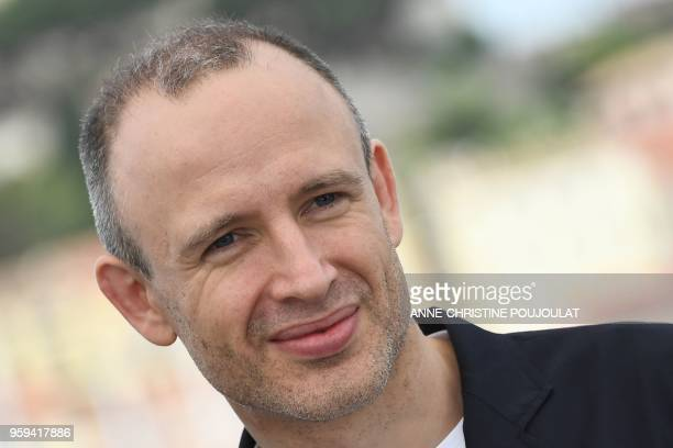 British editor Sam RiceEdwards poses on May 17 2018 during a photocall for the film 'Whitney' at the 71st edition of the Cannes Film Festival in...
