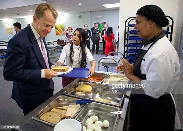 British Education Minister David Laws makes an official visit to Mulberry School for Girls in London on September 5 2012 Laws returned to the Liberal...