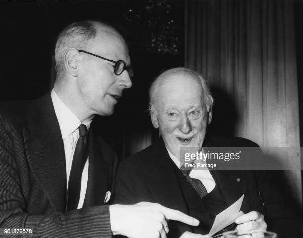 British educationalist Sir John Wolfenden and Professor Thomas Bodkin in conversation at the Foyles Literary Luncheon at the Dorchester Hotel in...