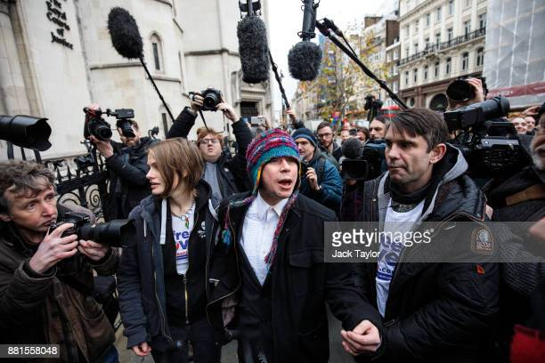 British electrical engineering student Lauri Love arrives with his girlfriend Sylvia Mann at the Royal Courts of Justice to appeal the decision to...