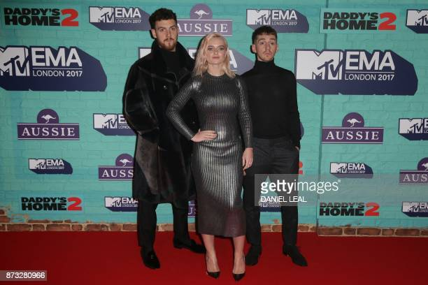 British electronic music group Clean Bandit Grace Chatto and brothers Jack and Luke Patterson pose on the red carpet arriving to attend the 2017 MTV...
