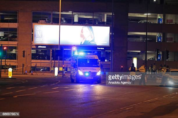 British emergency ambulance take casualties away from the Manchester Arena stadium in Manchester United Kingdom on May 23 2017 A large explosion was...