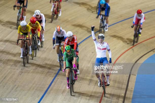 British Emily Nelson celebrates after winning the women's scratch final at the European track cycling championship in Apeldoorn on October 16 2019 /...