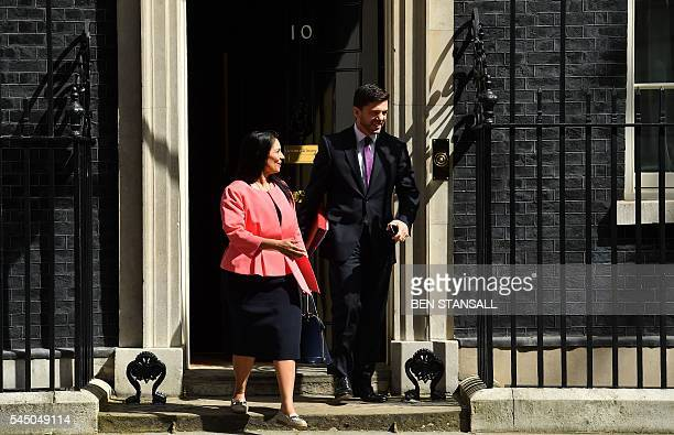British Employment Minister at the Department for Work and Pensions Priti Patel and British Work and Pensions Secretary Stephen Crabb leave after...
