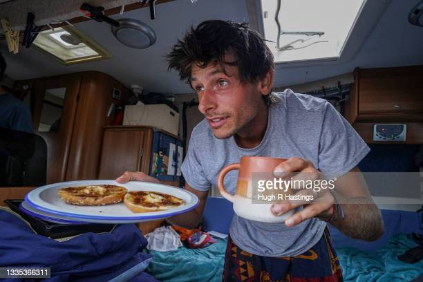 British endurance athlete and world record holder Nick Butter with his breakfast in the van in which he sleeps each night as he approaches the end of...