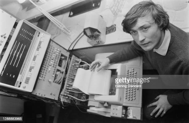 British engineer and composer Peter Zinovieff with a DEC PDP8 at the Electronic Music Studios in London, UK, January 1968.