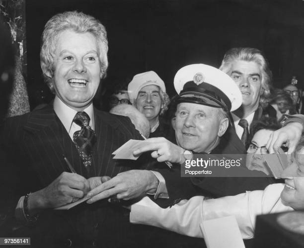 British entertainer and celebrated dragartist Danny La Rue signing autographs for fans outside the ABC One cinema on Shaftesbury Avenue London 15th...