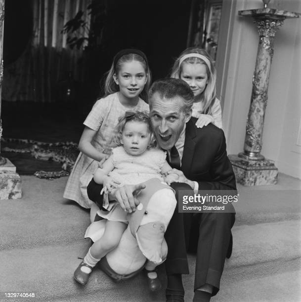 British entertainer and game show host Bruce Forsyth with his daughters Debbie, Julie and Laura at their home in Totteridge, London, UK, 24th...
