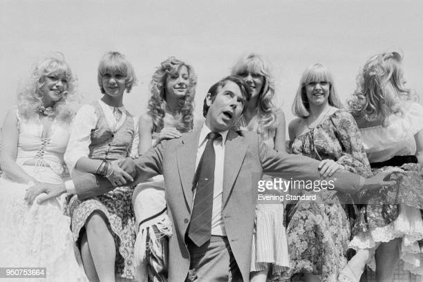 British entertainer and television personality Leslie Crowther with the dancers from his show 'The Blondes' Stephanie Lawrence Jill Nicholson Liz...