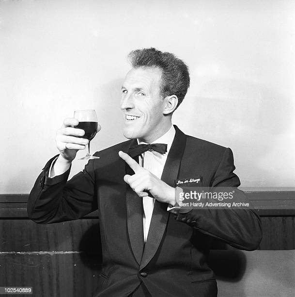 British entertainer Bruce Forsyth with a glass of sherry 10th June 1959