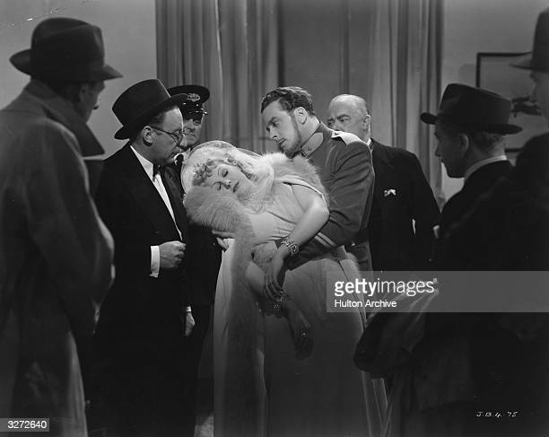 British entertainer Jack Buchanan catches the swooning June Knight in a scene from the film 'Break The News' Title Break The News Studio GFD / Trio...
