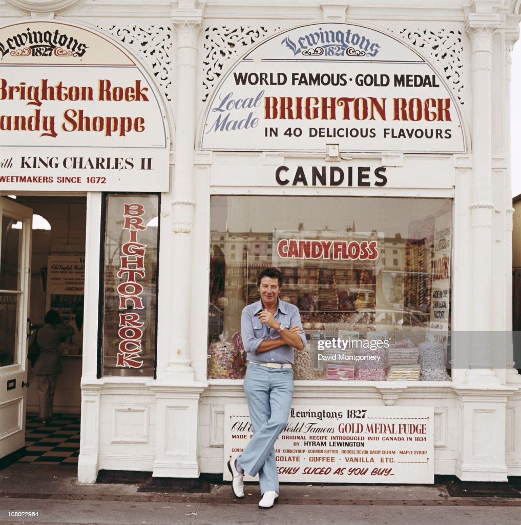 British entertainer Max Bygraves outside a sweetshop in Brighton, circa 1980.