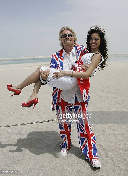 British Entrepreneur and businessman Sir Richard Branson poses with Miss England Hammasa Kohistani during a photocall on a stretch of sand on the...
