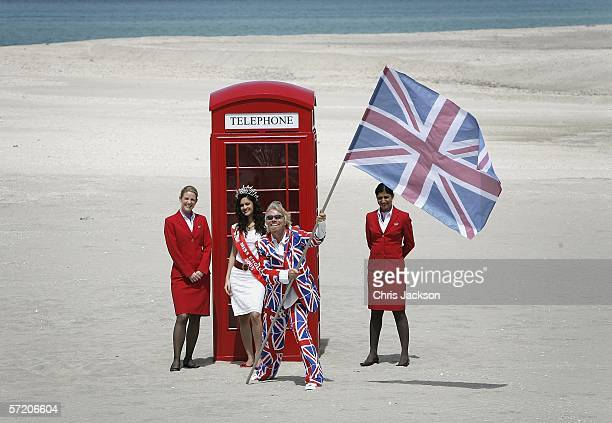 British Entrepreneur and businessman Sir Richard Branson poses with Miss England Hammasa Kohistani and Virgin girls next to a phone box during a...