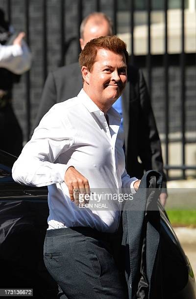 British entrepreneur Simon Fuller arrives at 10 Downing Street in central London on July 8 ahead of a reception with Tennis player Andy Murray...
